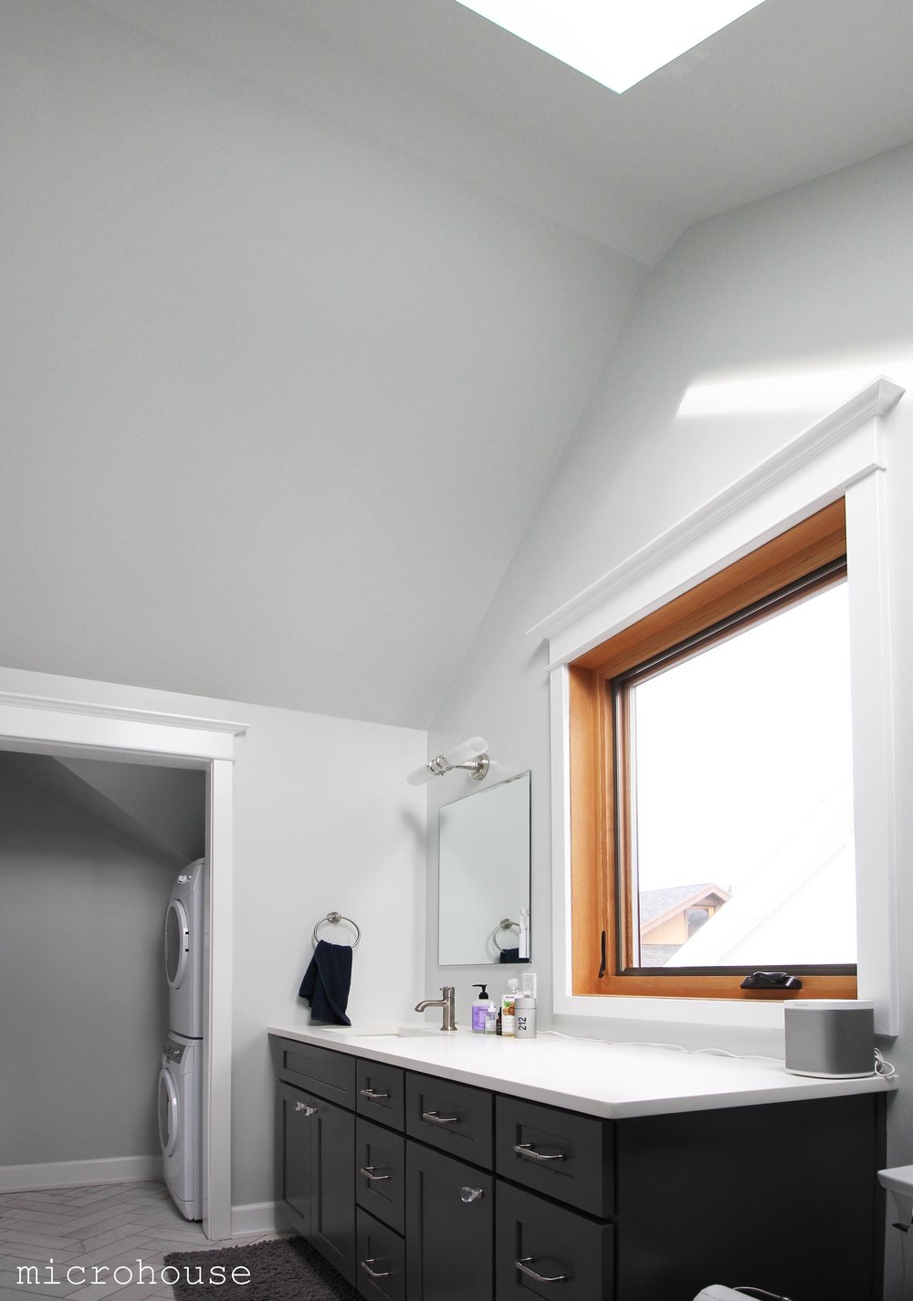 The master bath features vaulted ceilings and skylight.  A laundry room is tucked off to one side under the eaves.