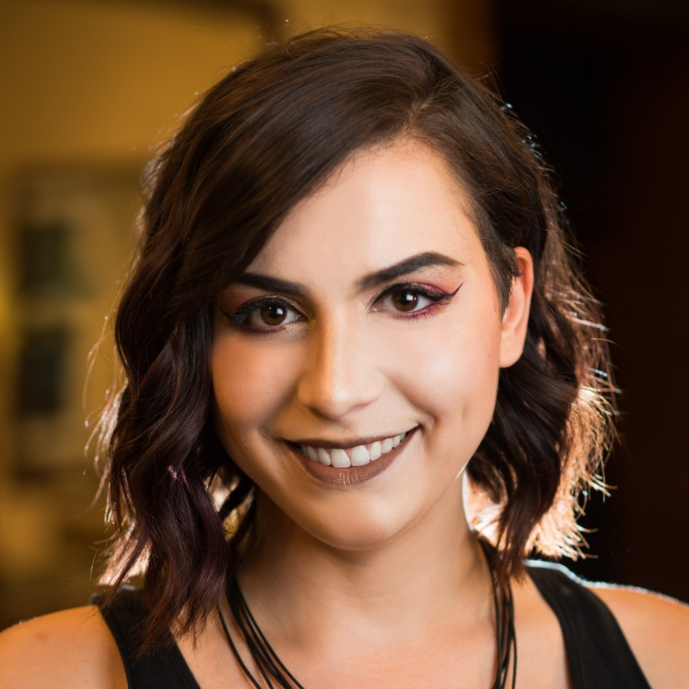 Adriana   Adriana graduated from the cosmetology program at the Institute of Beauty and Wellness in 2016. After honing her skills through our in-house Assistant training program, she became a full-fledged stylist in 2018. Adriana loves all aspects of doing hair as a career, but her absolute favorites are styling, Deva cuts, creative color, and long men's hair. In her spare time, you'll find Adriana playing with the latest makeup palettes and living her best life as a gluten-free cat mom.   DevaCurl certified