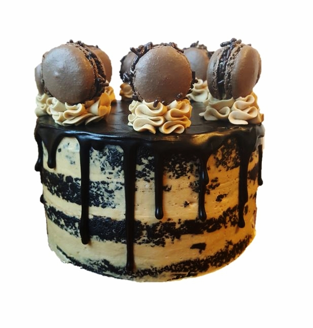 "MOCHA A decadent treat for any coffee and chocolate lover. Dark chocolate-mocha cake layered with luxurious mocha Italian meringue buttercream. Topped with dark chocolate ganache and mocha macaron.  4"" ($25), 6"" ($35), 8"" ($50), 10"" ($65), 12 Cupcakes ($30)"