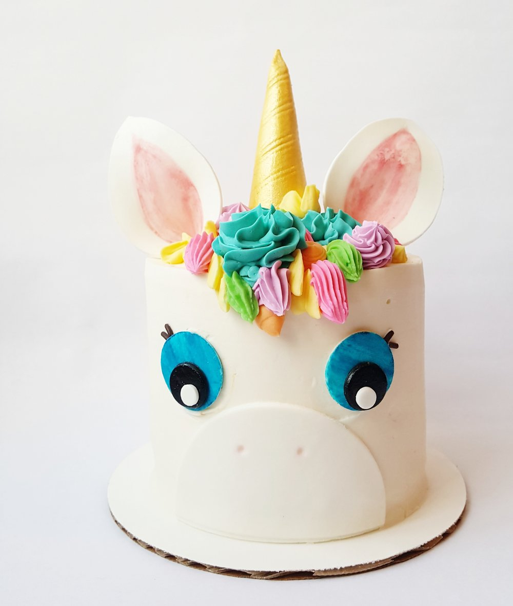 "RAINBOW UNICORN This cake is all things magical! When sliced, a beautiful rainbow is revealed! 4"" ($35), 6"" ($55), 8"" ($75), 10"" ($100)"