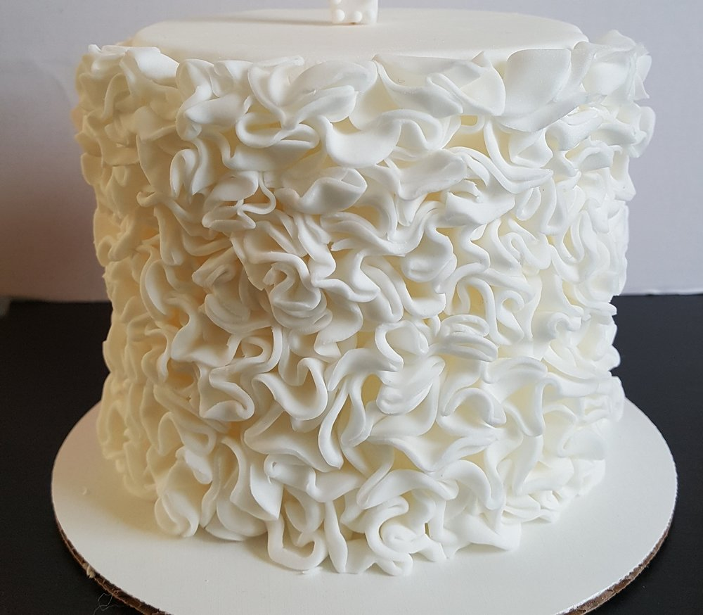 "Squiggles   Sugarpaste covered cake in color of choice.  6"" - £50 / 8"" - £70 / 10"" - £85/ 12"" - £105"
