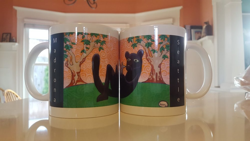 Madrona Mugs - Featuring our panther from the Henry Mural, sales of these mugs help fund Arts Programming at Madrona. On sale at the Hi-Spot (and at school events) for only $12!