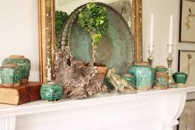 Mantel with plate in front of mirror - interesting.jpg