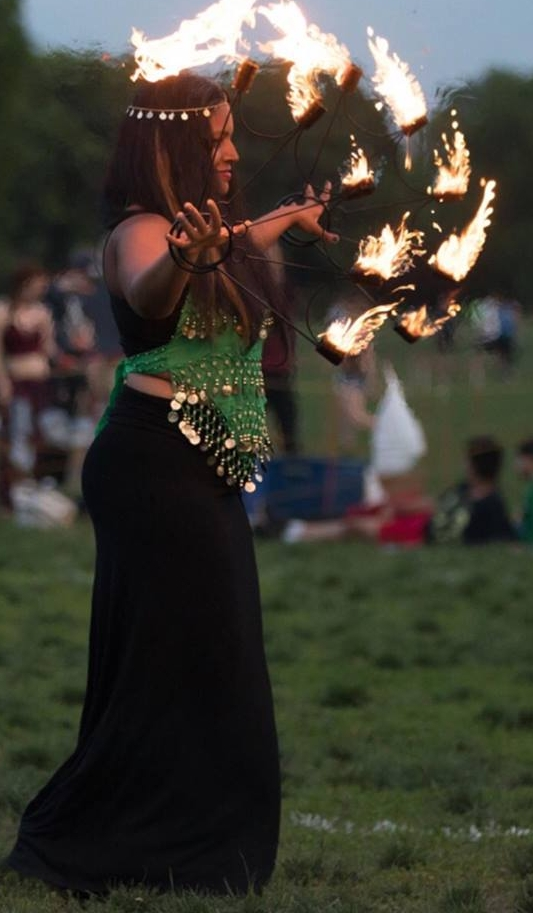 - Flow Like the Elements with Radia Ali (5-6pm Outdoor Alcove)My flow workshop is going to cover basic fire safety rules, the art of letting the body flow in rhythm with drums/ acoustic music, introducing fire props with some historical perspective on where fire play began, basic movements for using fire fans and fire swords and hoops (students will not be touching fire or fuel at any time), ending with salutation to the elements, and hopefully sparking a new appreciation for the way in which Fire has been used as a sacred art form.Radia Ali seeks to spread awareness of different cultures and ideas through dance. Her sincere hope is that her choreography will spark curiosity, and expose people to the different ways in which humans connect through Movement and Rhythm globally!