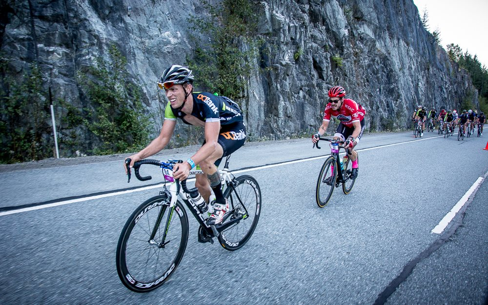 Jacob racing for H&R at the 2015 Whistler Gran Fondo. Being chased by one of his athletes.