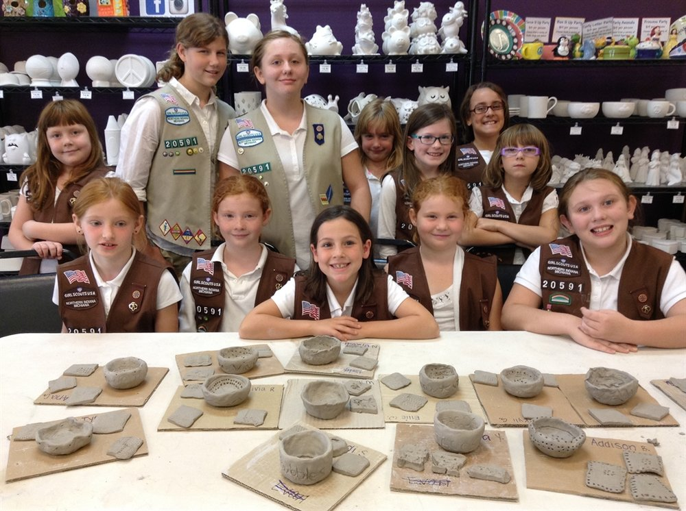 """Brownie Pottery Badge Cost: $15 per scout    Includes:   Introduction to making clay pinch pots, slip and score and attaching clay details.  Learning the terminology associated with clay.    Painting your clay piece.   In studio events, will take a """"backstage tour"""" of Cafe Monet Art Studio which includes basic kiln firing information and meeting our kilns.  All pinch pots will dry for two weeks prior to being fired in our kilns.   Finished pinch pots are for decorative use only.  1.5 hours of creative fun-time  6 scout minimum  Party Room Fee waived ($50 value)  Snacks and Drinks permitted.  Actual Badge must be purchased from the Scout store."""