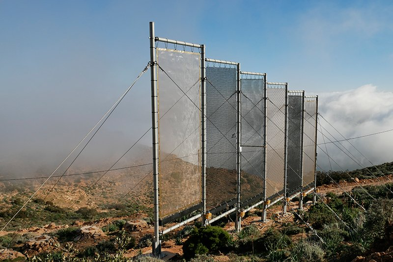 Mesh billboards on the Moroccan mountainside will soon be joined by numerous others—a planned 31 in all—to create the world's largest fog collection facility. (Aqualonis)