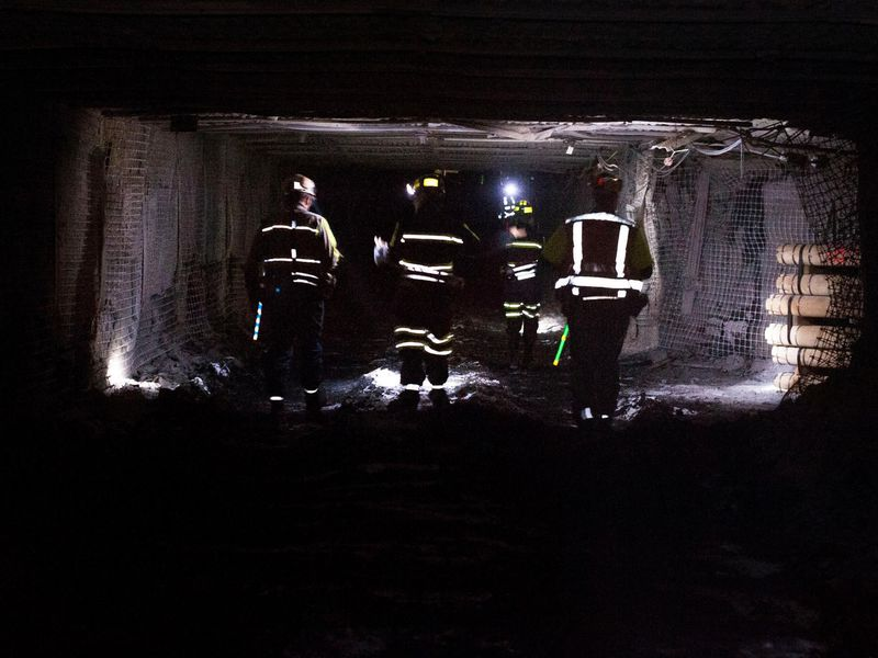 Coal miners walk through a tunnel at the Consol Energy Bailey Mine in Wind Ridge, Pennsylvania in 2013. (Getty Images)