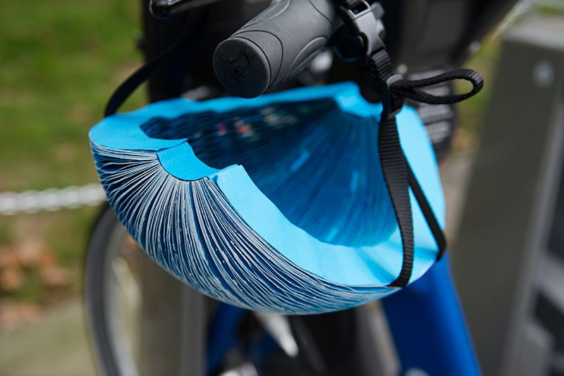 The EcoHelmet is a foldable, recyclable helmet constructed of paper with a water-resistant coating. (James Dyson Award)