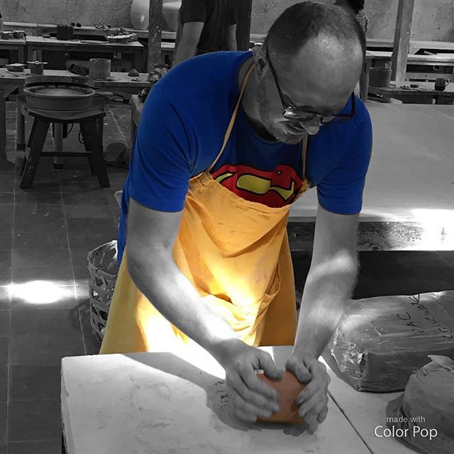 Even Superman has to wedge. #clay #work #wedging #warmup #throwing #pottery #wheel #studio #ceramics #member #practice #hardwork #clayeverydamnday #eatclaylove #bali