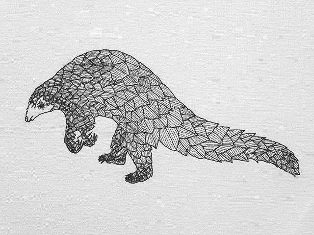 #handembroidery #endangeredspecies - Our new cushion cover, Pangolin, in danger of becoming extinct.