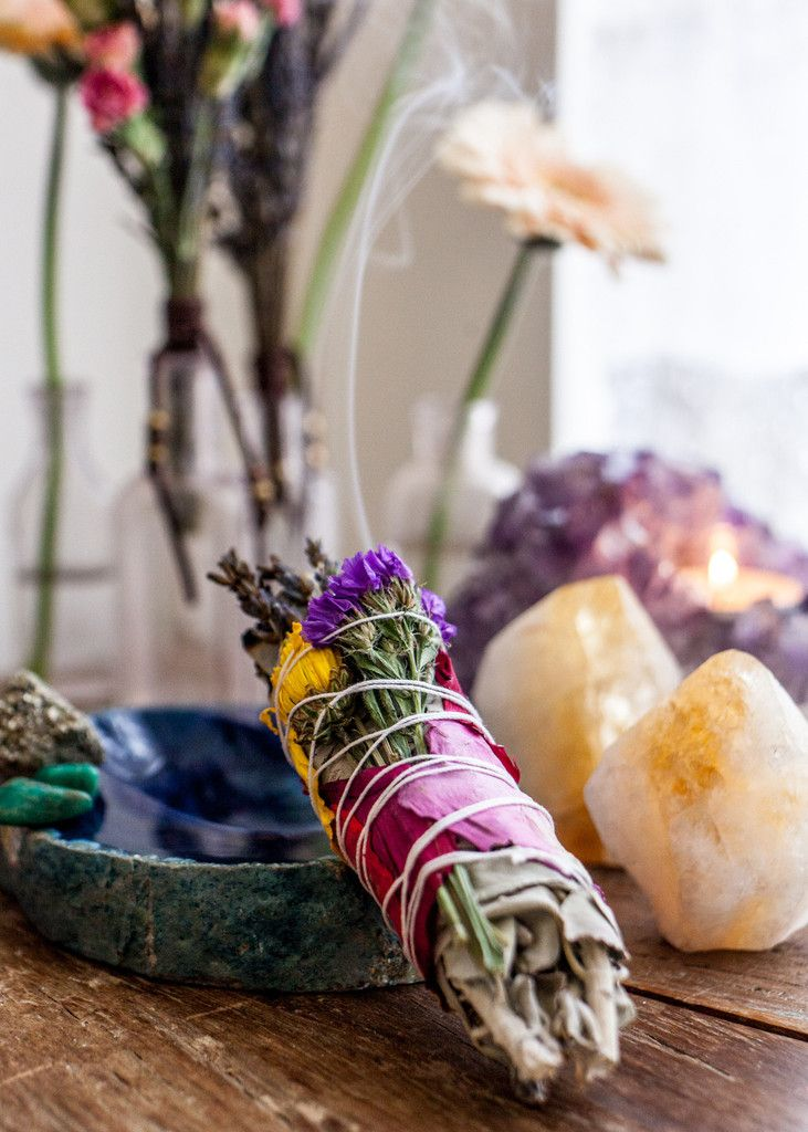 Sage, crystals, candles, & flowers