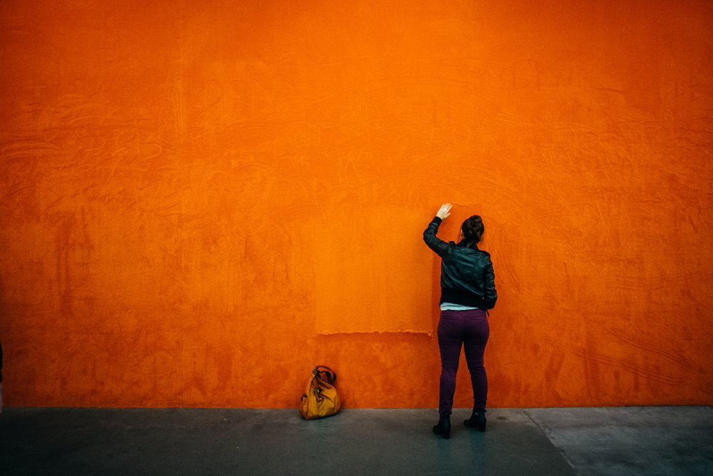 A woman engages with Rudolf Stingel's installation,  'Untitled' .  - Tate Modern, London.