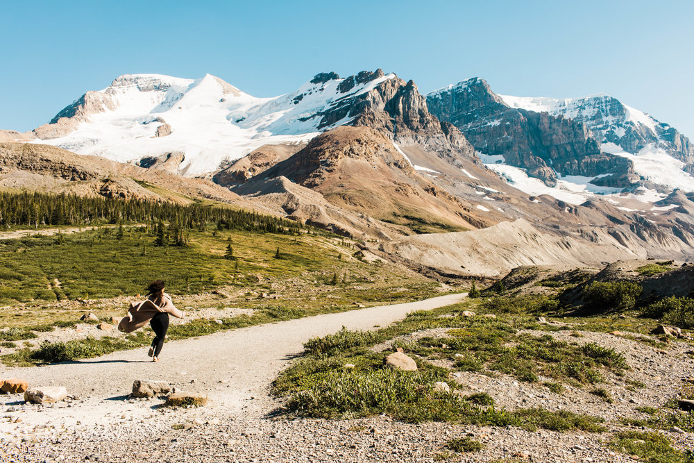 Running by a glacier in the mountains | Best Asheville wedding photographers