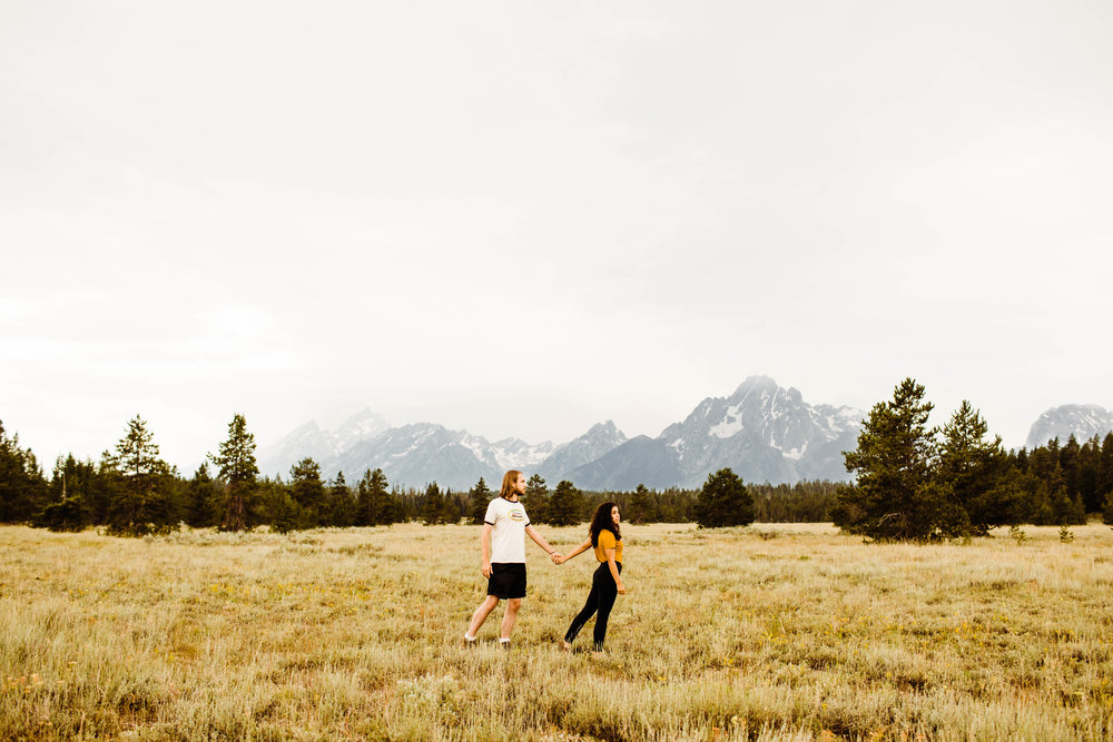 Engagement photos while walking through the Tetons | Best adventure wedding photographers