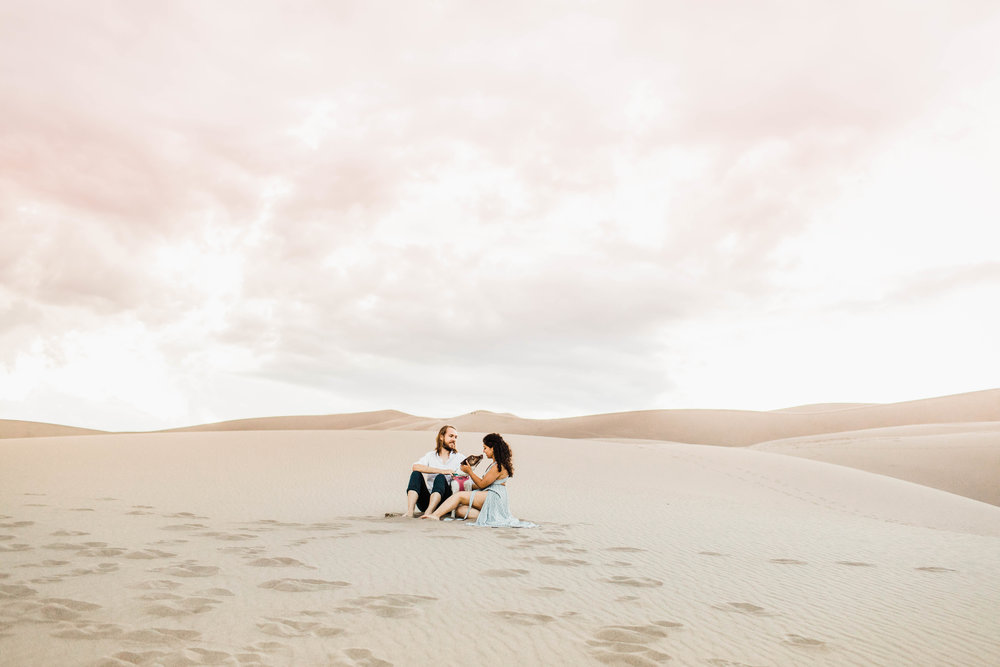 sand dunes adventure engagement session with puppy | Best Colorado Elopements