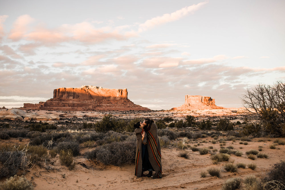 Snuggling under a blanket in Moab Utah | Best Charlotte wedding photographers