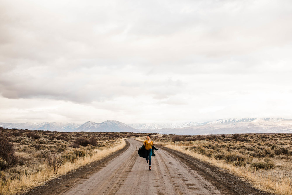 Running on a dirt road in the Rocky Mountains | Best Colorado wedding photographers
