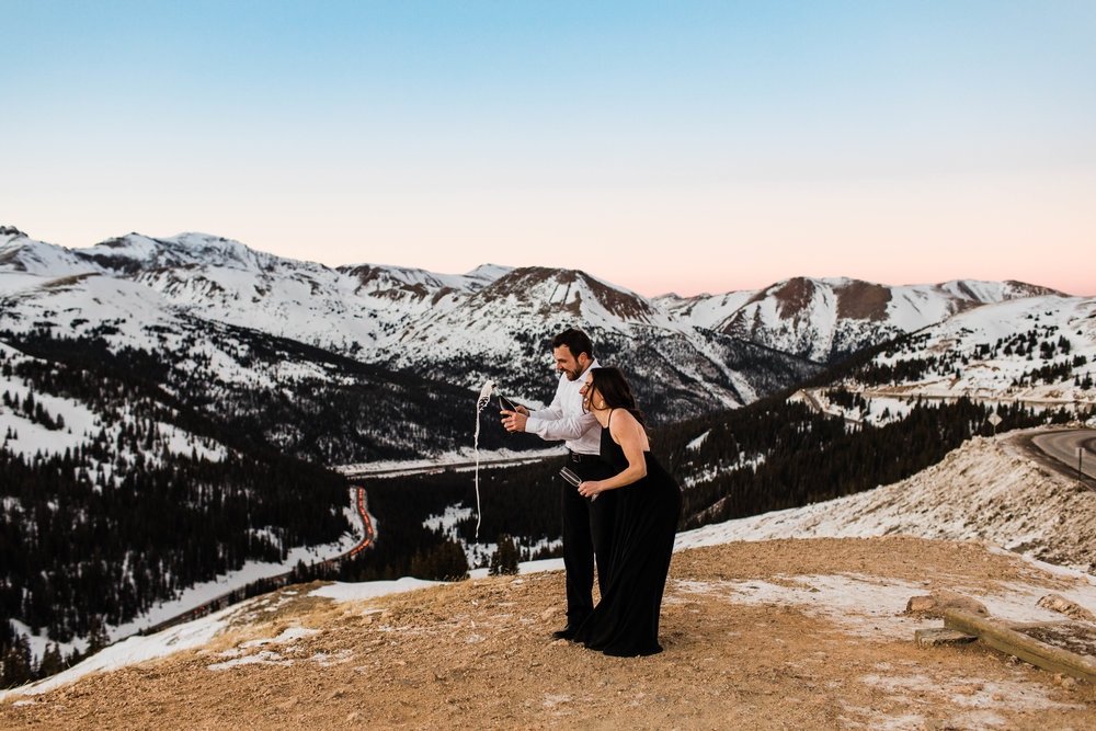 Popping champagne on top of a mountain | Colorado Elopement Photography
