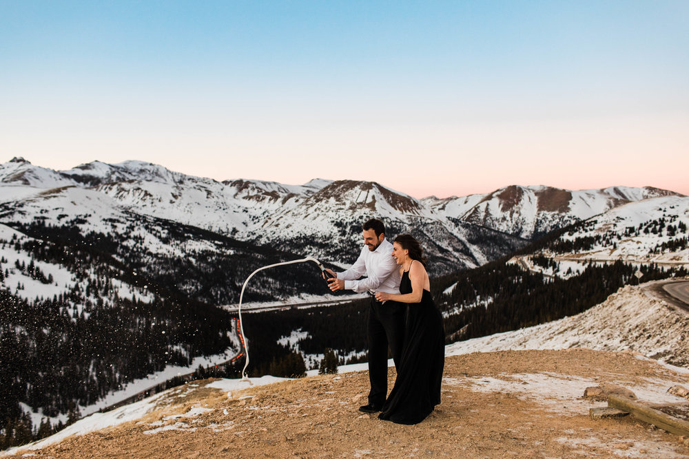 Popping champagne in the Rocky Mountains | Colorado Elopement Photographer