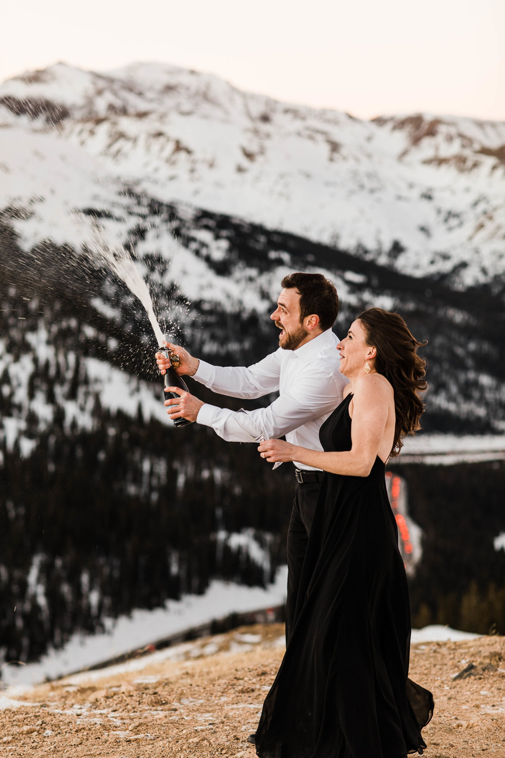 Popping champagne in the Rocky Mountains | Best Colorado Elopement Photographer