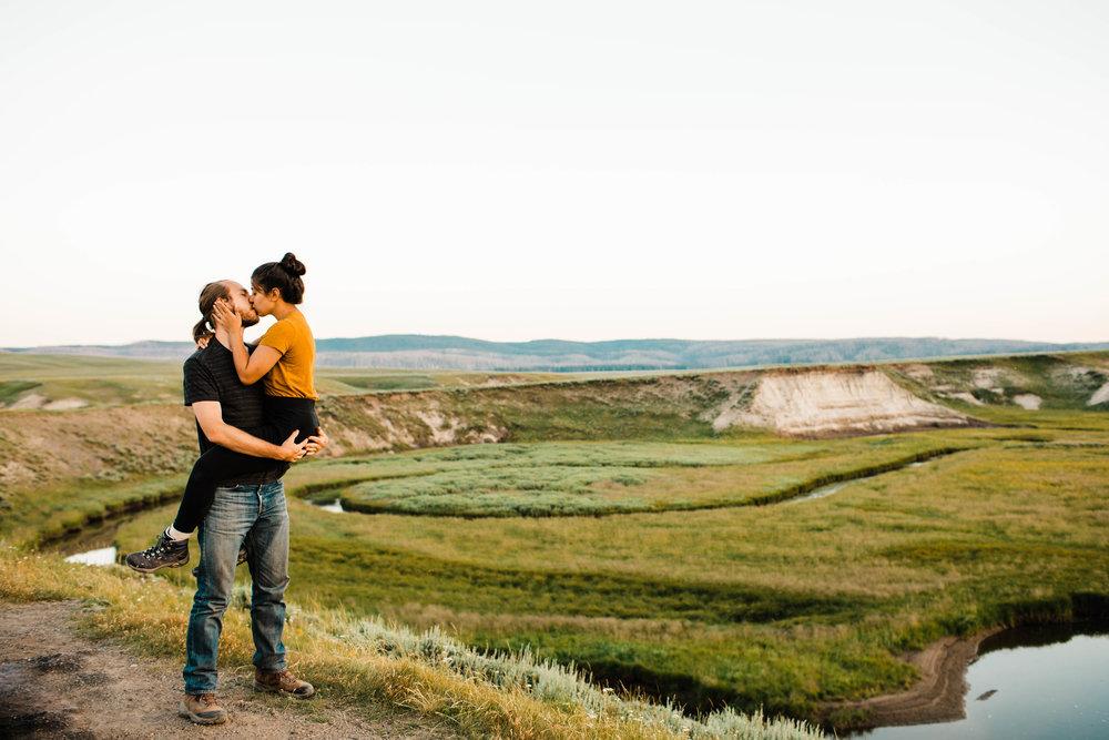 national park elopement photographers kissing in an open field | Best Asheville Wedding Photographers