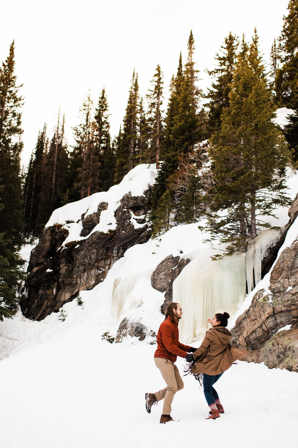 Dancing by a frozen waterfall in the Colorado Rocky Mountains | Best Colorado Elopement Photographers