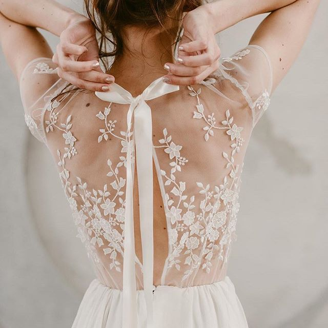 The lace detail on this illusion back is stunning! via @weddingphotomag #wedding #weddingday #weddingdress #weddingblog #weddinginspo #lace #lacedetail #illusionback #white #dress #dressinspo #bride #bridalinspo #bigday #ido #gettingmarried #bridalfashion #florals #beautiful #stunning #ribbon #bow #classy #pursuepretty #elegant #love #parsimonyinspired