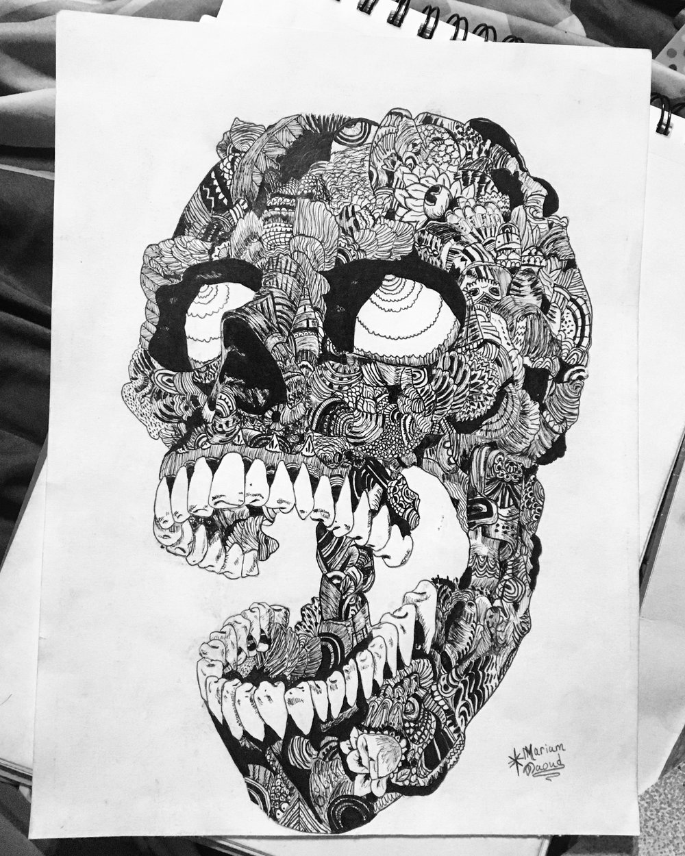 I was inspired by the Latin Day of the Dead holiday and their sugar skulls, but I took a more dark approach to it and I used a zentangle technique. The day of the dead art intrigued me and I gave it a try because it's very complex yet it comes together to create one image; for example, the skull.