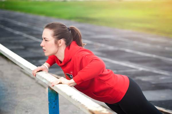 Strong woman doing push up outdoors. Pavel B stock-photo-158693103.jpg