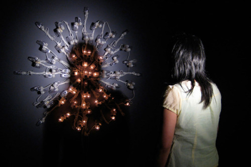 Image: Dark into Light, 2008, mixed media installation: 100 night lights, par can, spot bulb, interaction view
