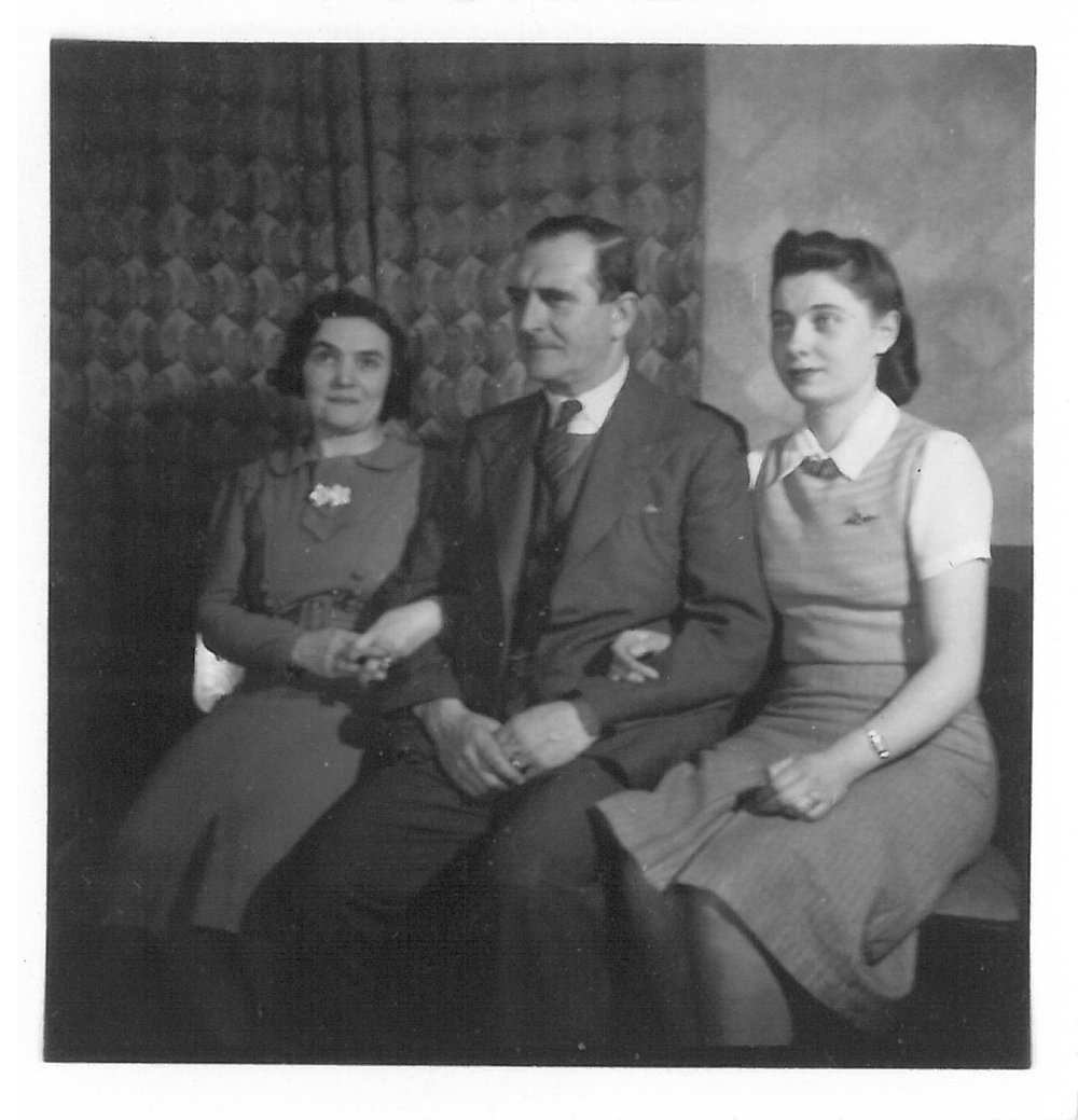 Irene (right) with her parents in their London flat, circa 1940. No known copyright restrictions.