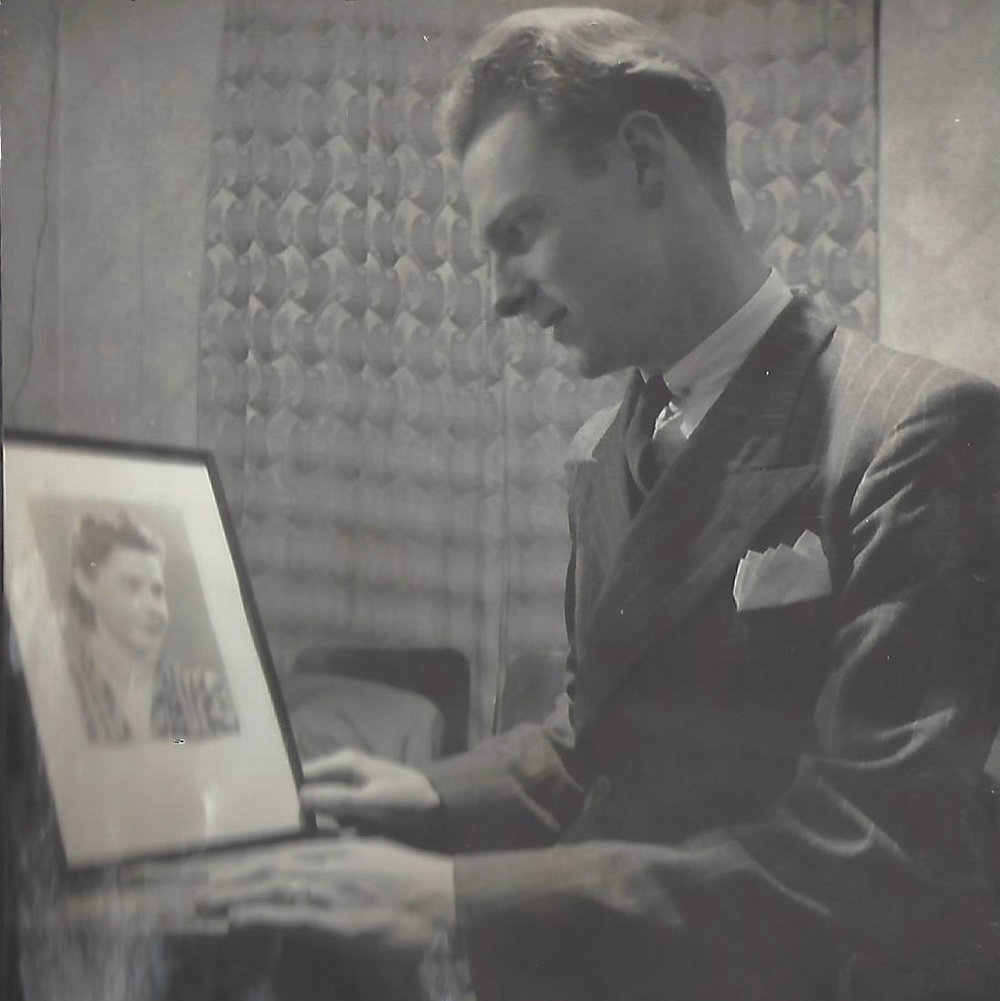Mac looking at a photo of Gran, probably 1941. No known copyright restrictions.