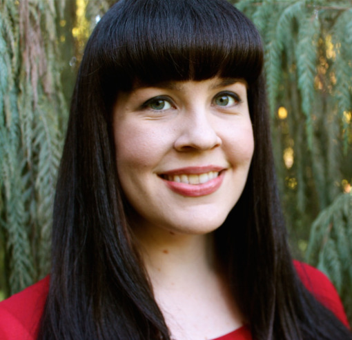 caitlin_doughty_in_red_evergreen_background-copy.jpg