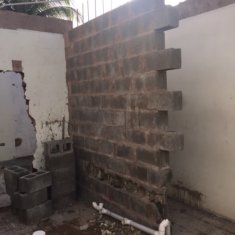 To get that coveted open concept living room/kitchen we have to put in a new mason beam atop this wall. The problem is the wall was build like sh!t TWICE! that's why we had to get rid of the last guy and start anew. #ajdesigned #jaderenovation  (at 500 Chaguanas)