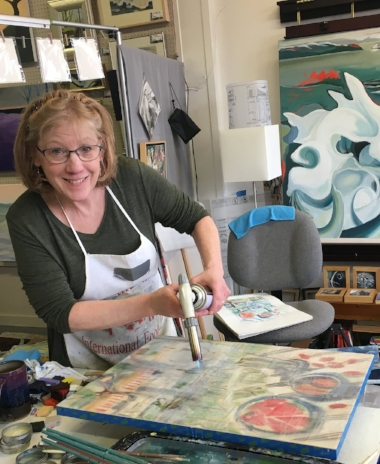 Phyllis fusing an encaustic painting for Park Ave Art Fest poster (photo by Maureen Outlaw Church)