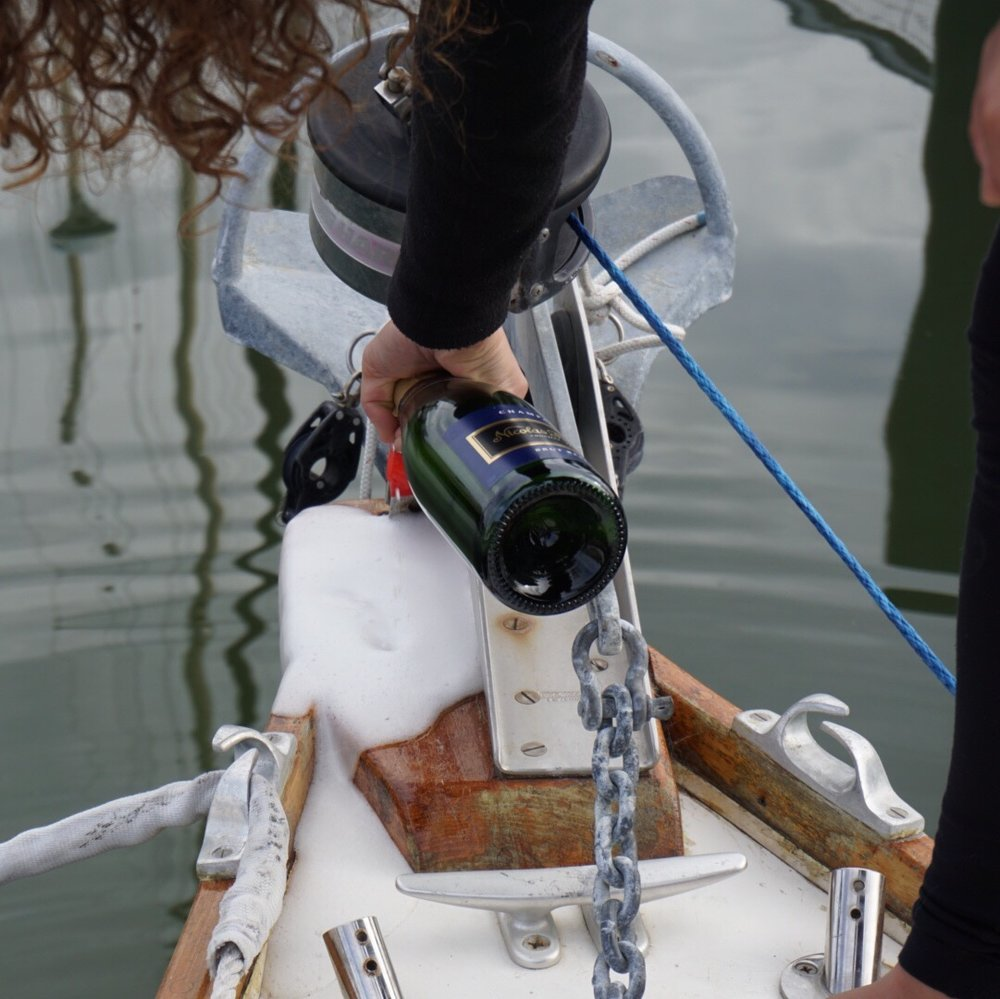 sweet windfola didn't deserve violent bottle-smashing, so we just bathed her bow gently in champagne