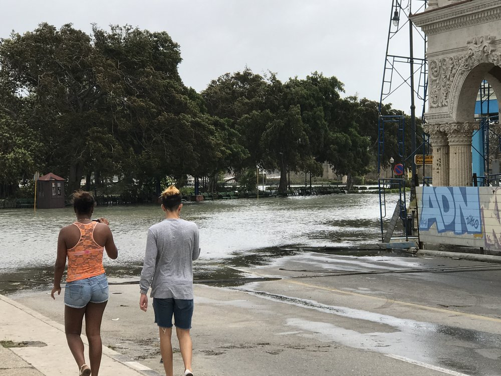 People viewing and recording the flooding.