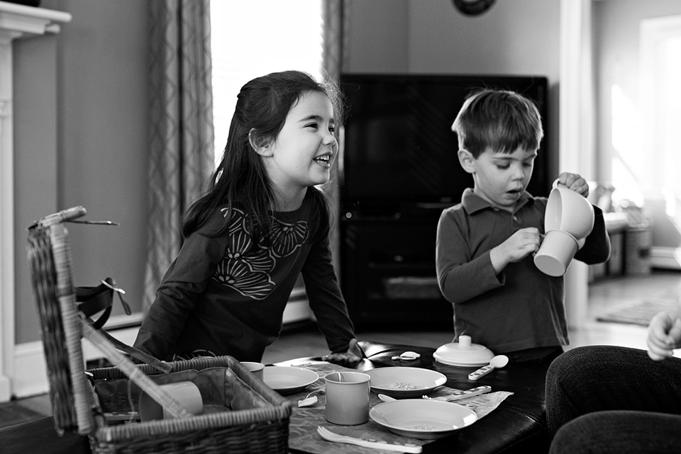 girl smiling while playing tea party with brother west hartford ct documentary photography