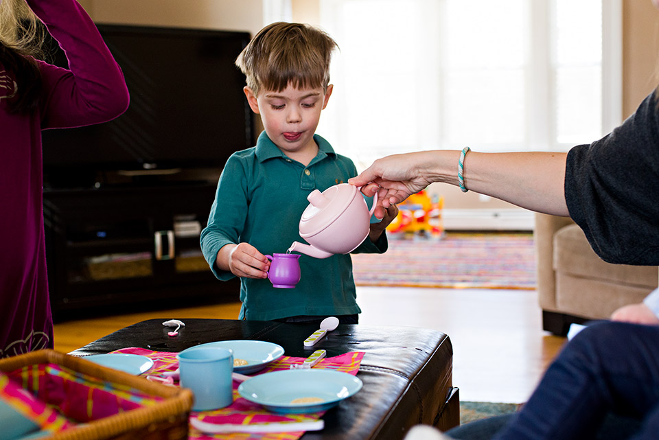 mom pours tea at tea party for son west hartford ct documentary family photography