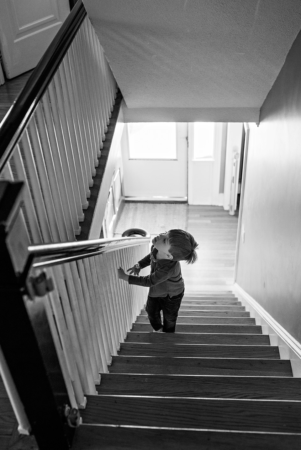 boy walking up the steps to his bedroom west hartford ct documentary family photography