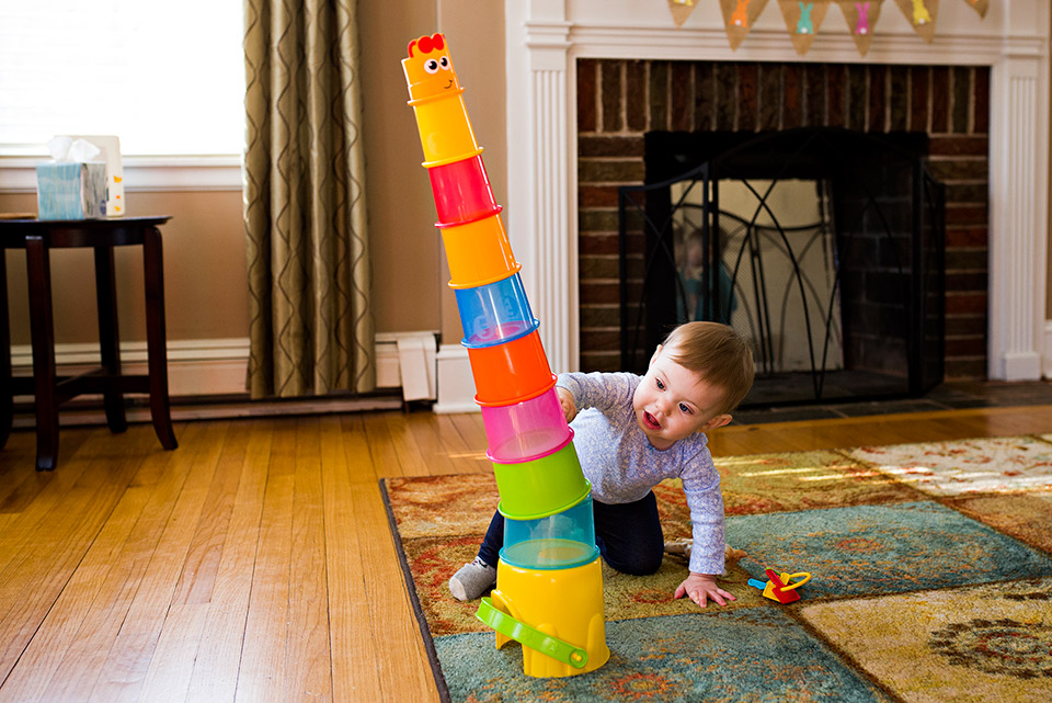 baby knocking down stacking cups west hartford ct family documentary photography