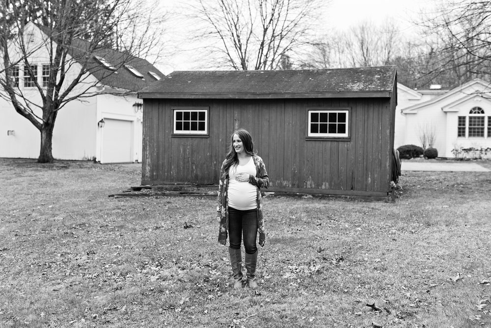 pregnant women standing in front of a barn at burlington connecitcut maternity photography