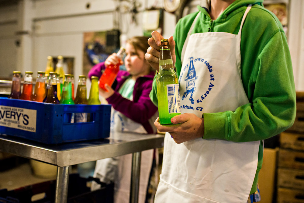 hand mixing green soda at averys soda new britain ct family documentary photography
