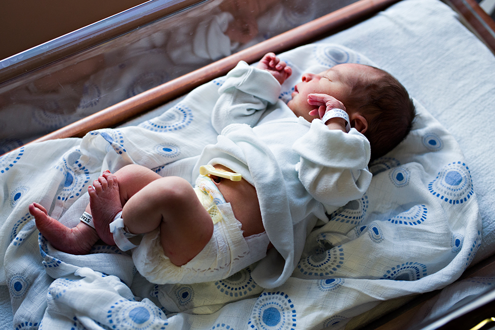 newborn baby in hospital bassinet with hospital bracelets middletown connecticut fresh 48 birth space photography