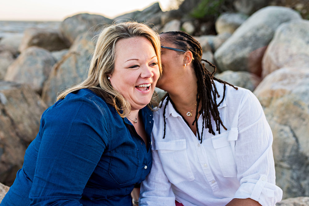 two women laughing at hammonasset beach connecticut engagement photography
