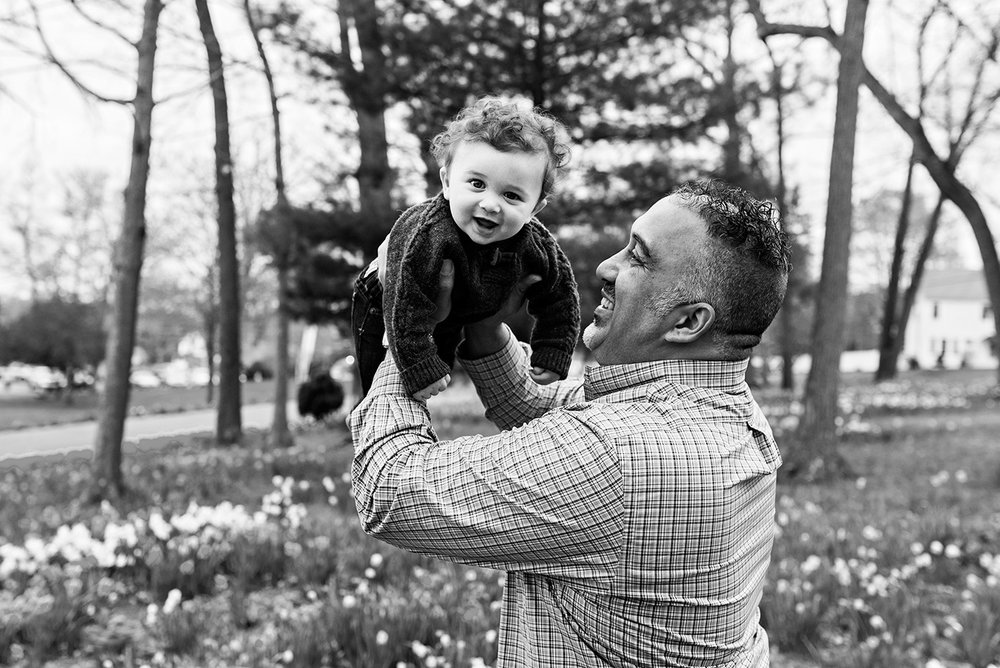 father holding infant son smiling at hubbard park meriden connecticut family photography