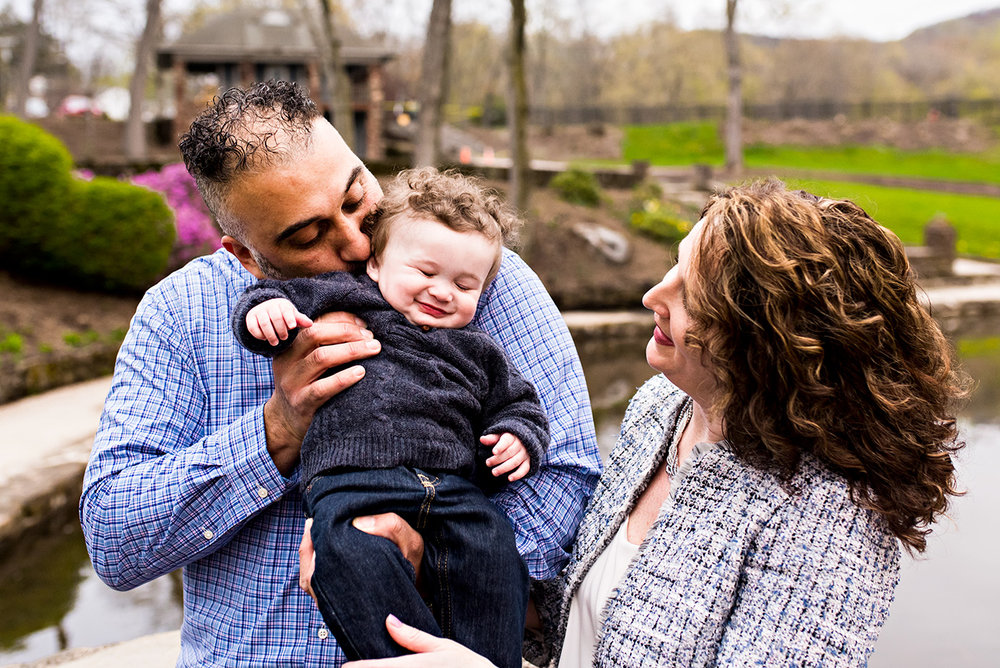 father kissing infant son's neck while giggling hubbard park meriden connecticut family photography
