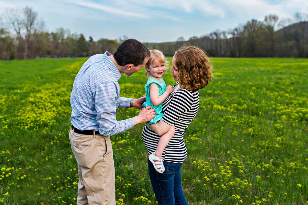 dad tickling daughter in field at haddam meadows in haddam connecticut lifestyle maternity photography