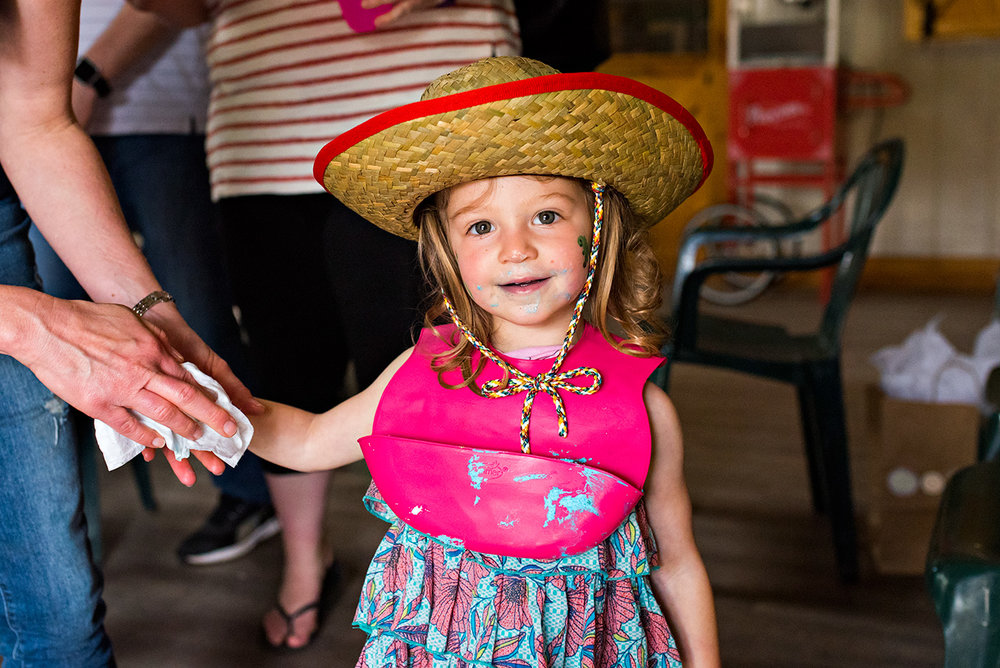 girl with cake on face and cowboy hat ct family photographer